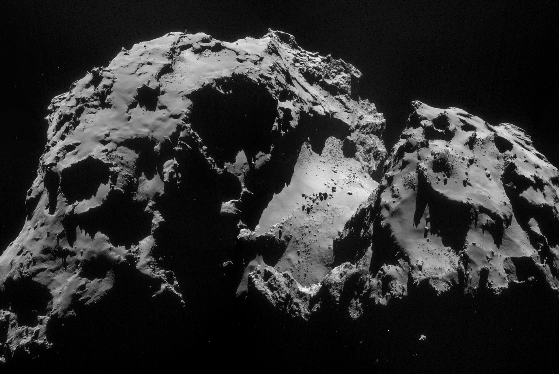 Lander in awkward spot on comet, but sends pictures